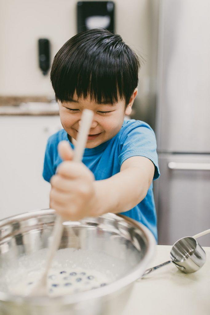 Boy cooking at Enrichment Programs
