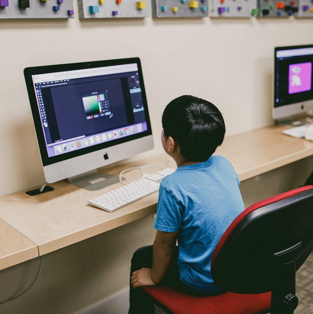 Boy using a iMac at Spark class