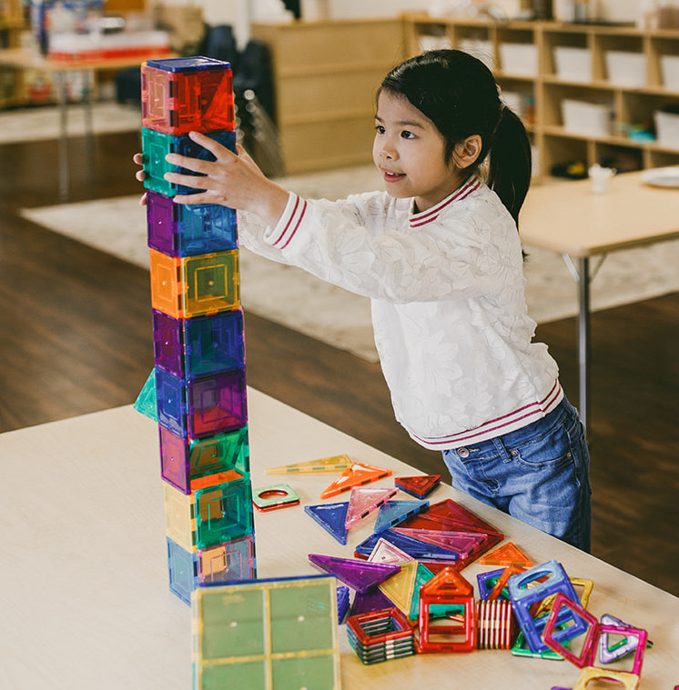 girl playing with color blocks at Spark