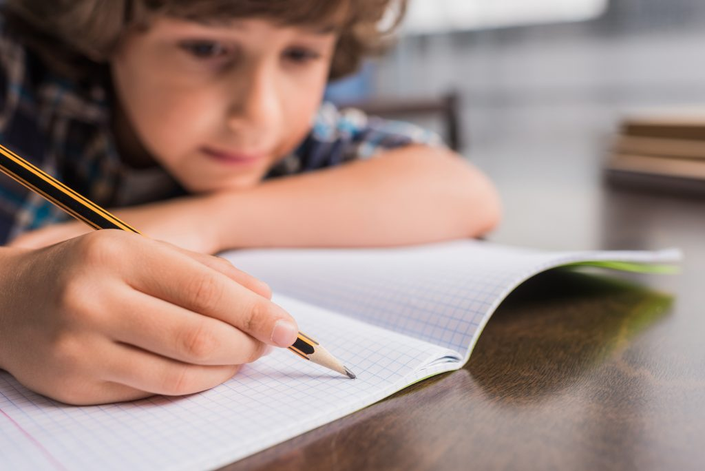 boy reading and writing